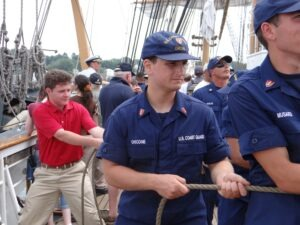 Richard Dent heaves rope with Coast Guard crew
