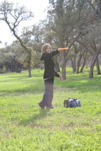 Kid playing disc golf at Zilker Park during the Ice Bowl