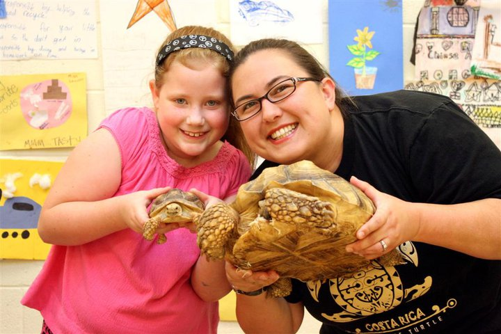 A Student and Teacher Enjoy Holding Reptiles Through Austin Reptile Shows