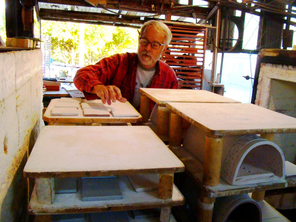 John Gray Loads Kiln at Clayworks