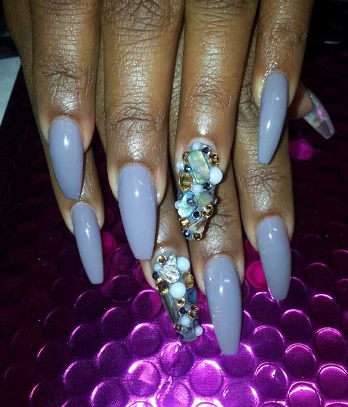 Bling nail art with jewels and prisms