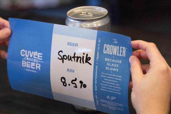 Putting Label on Cuvee Crowler