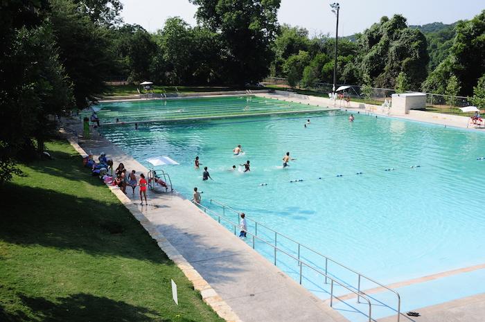 People swimming Deep Eddy Pool Austin