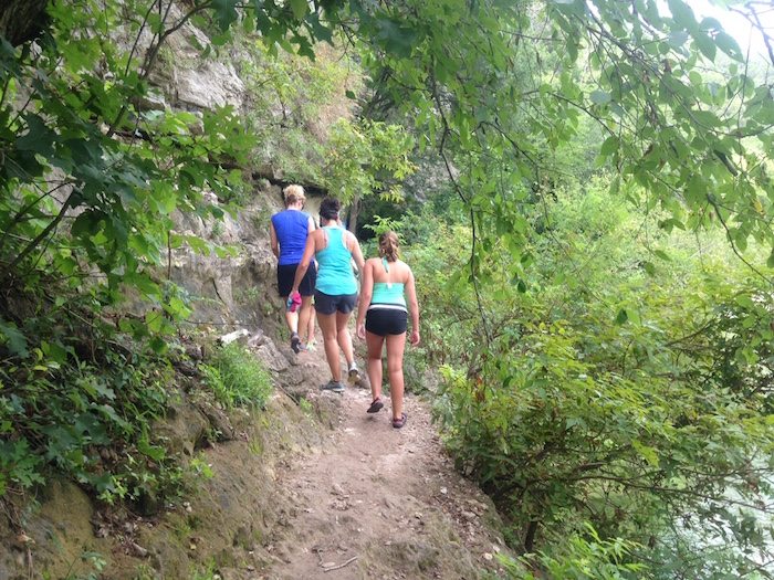 Hikers make their way on the Barton Creek greenbelt toward the Violet Crown Trail