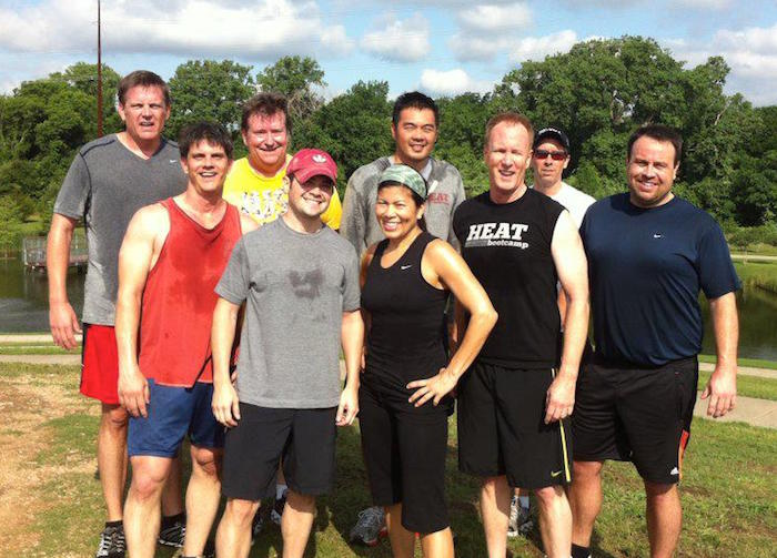 HEAT Bootcamp members, sweaty after a group workout