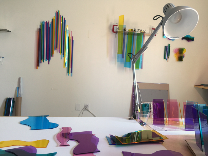 Melissa Borrell work table and studio wall of experimentation