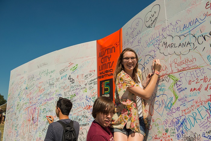 Kids Sign the ACL Fest Anniversary Wall