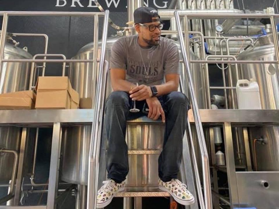 Weathered Souls owner Marcus Baskerville sitting in brewery