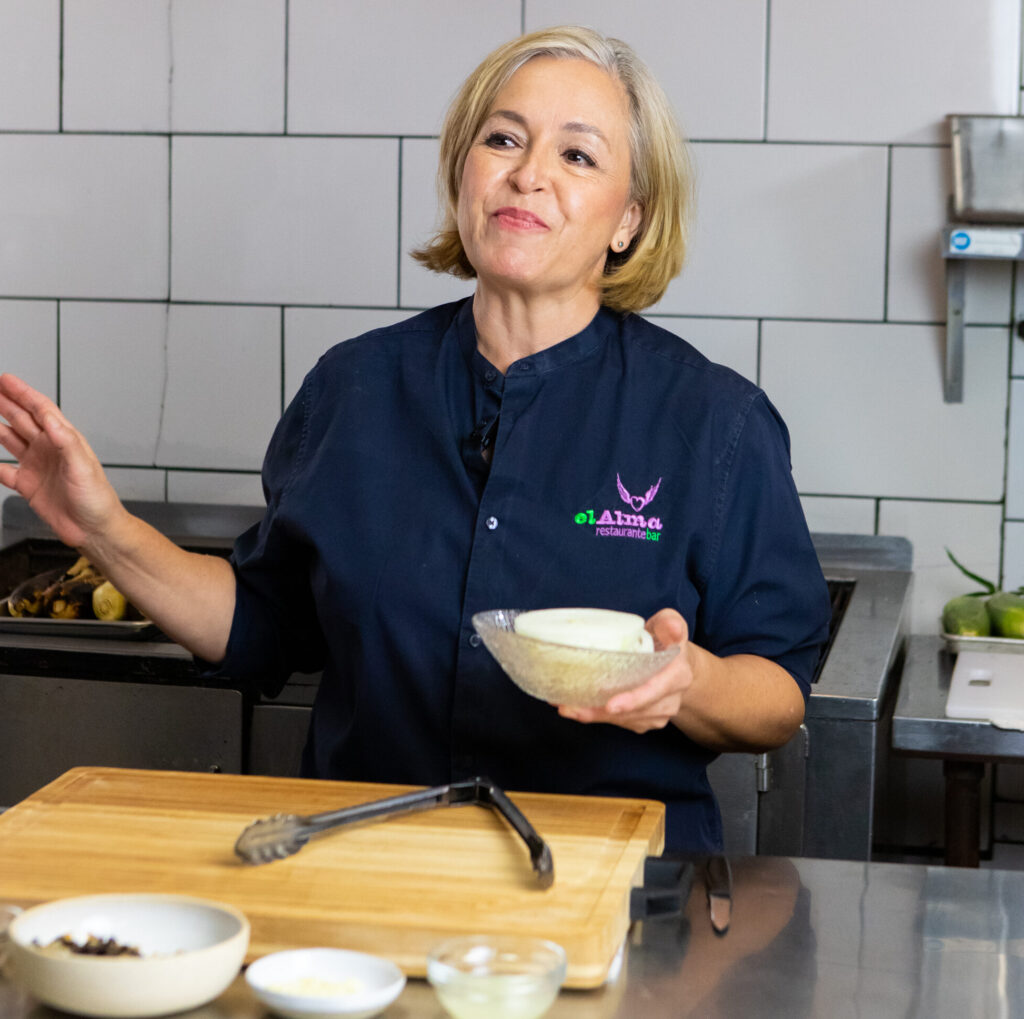Chef Alma holding a bowl
