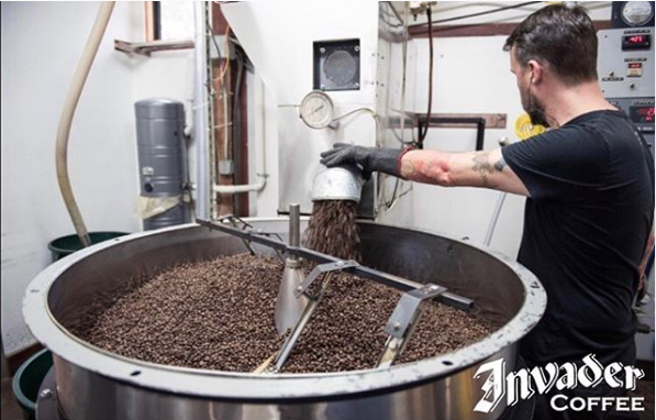 Air roasting coffee beans at Invader Coffee.