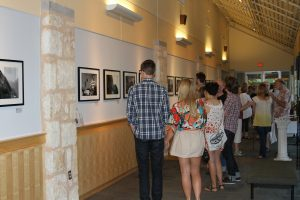 Visitors to Gallery at the J examine Daniel Read's exhibit