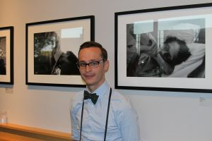 Austin photographer Daniel Read with his Documenting Dignity exhibit