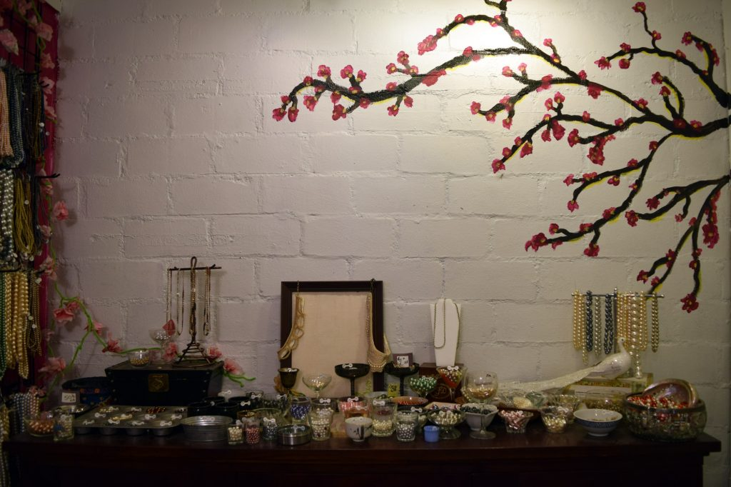 Table at Bead It with Tree Painting