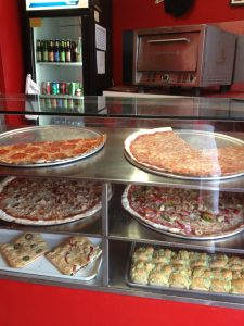 Pizza by the slice at East Side Pies