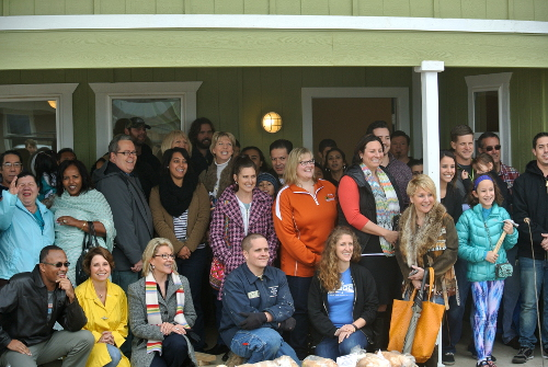 Habitat for Humanity Families and volunteers pose for a picture