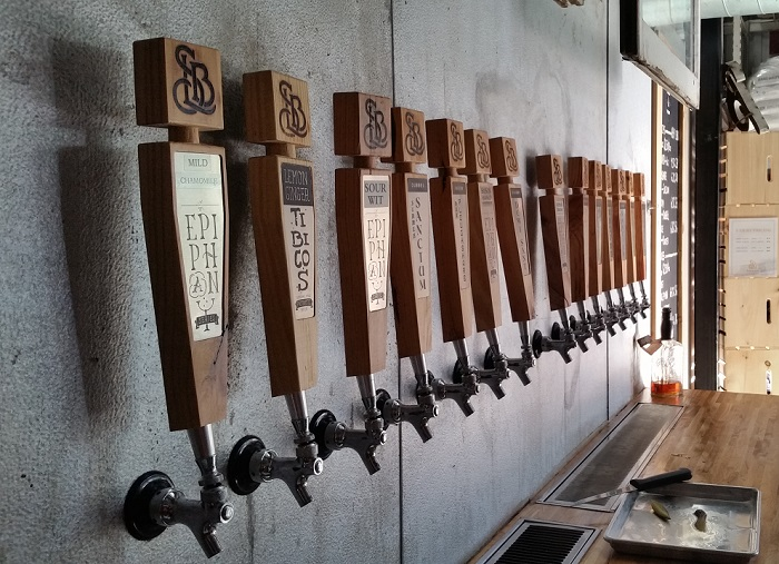 Strange Land Brewery Tap Wall