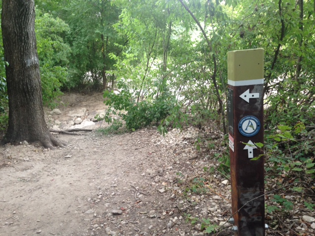 Violet Crown Trail marker at the Barton Creek greenbelt trail intersection