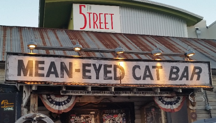 Mean Eyed Cat Sign
