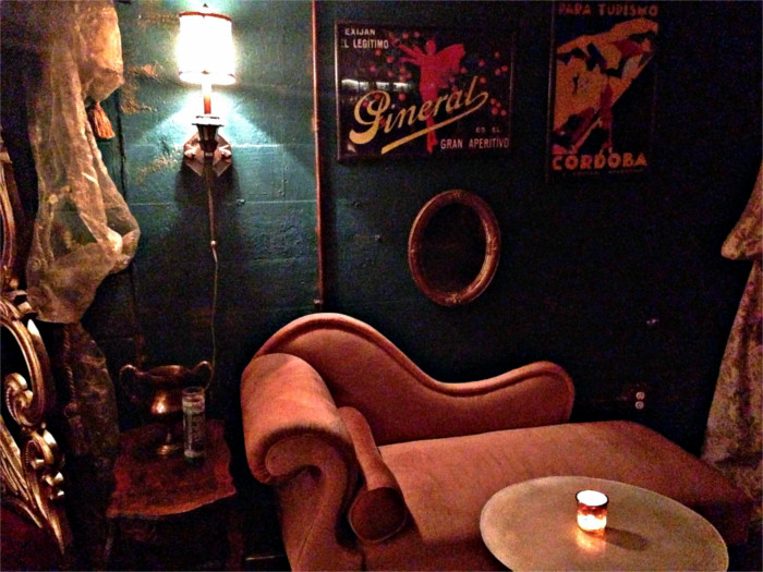 Framed posters deck the walls of the Milonga Room speakeasy