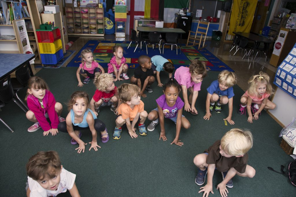 Pre-k students in frog pose