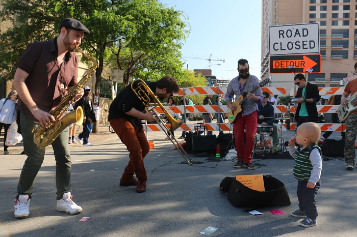 Karikatura Performs On Street For SXSW Toddler