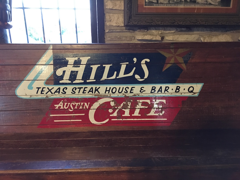 Hill's Cafe Texas Steak House and Bar BQ Sign