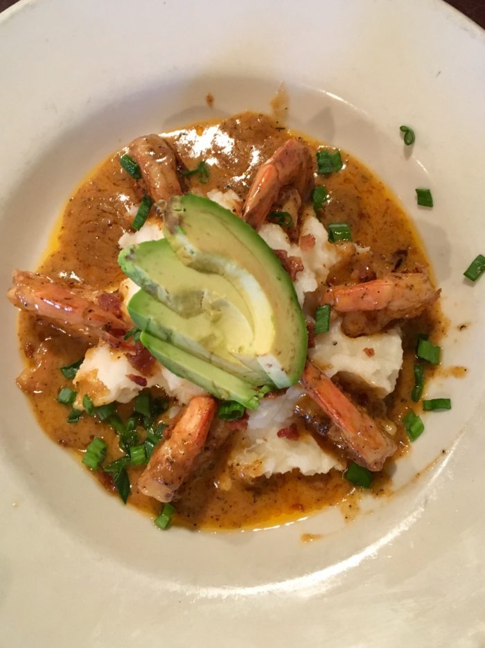 Shrimp and grits with avocado slices