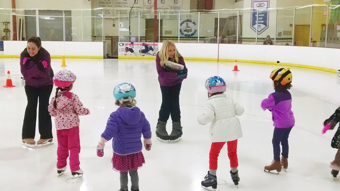 Skate instructors teaching ice skating to ages 3-5