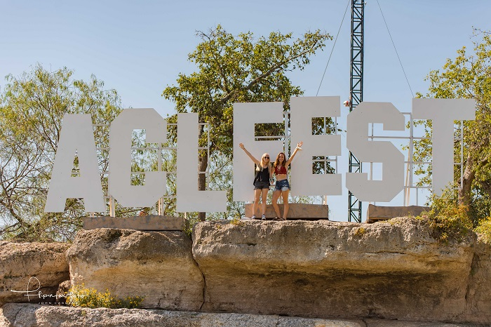 Teens Climbed Up to ACL Fest Sign