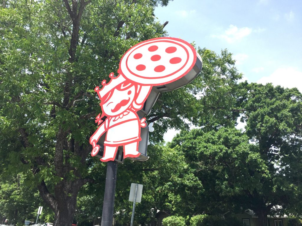 Queen of Pies Home Slice Sign at North Loop Location
