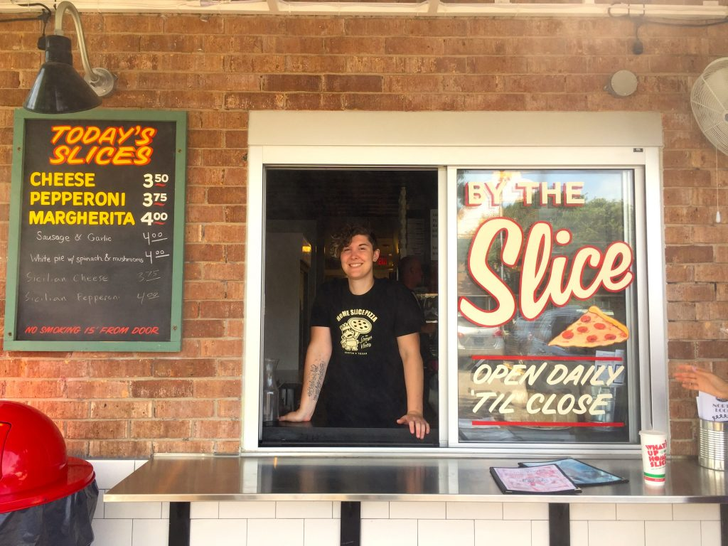 By the Slice window at Home Slice Pizza North Loop in Austin