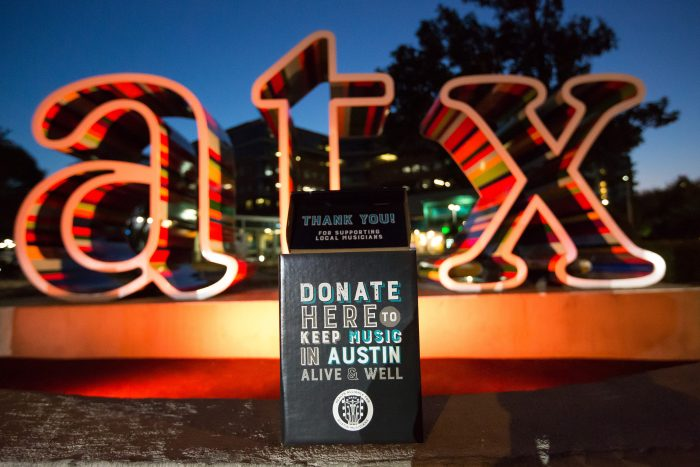 Picture of a sign calling for donations to Austin musicians.