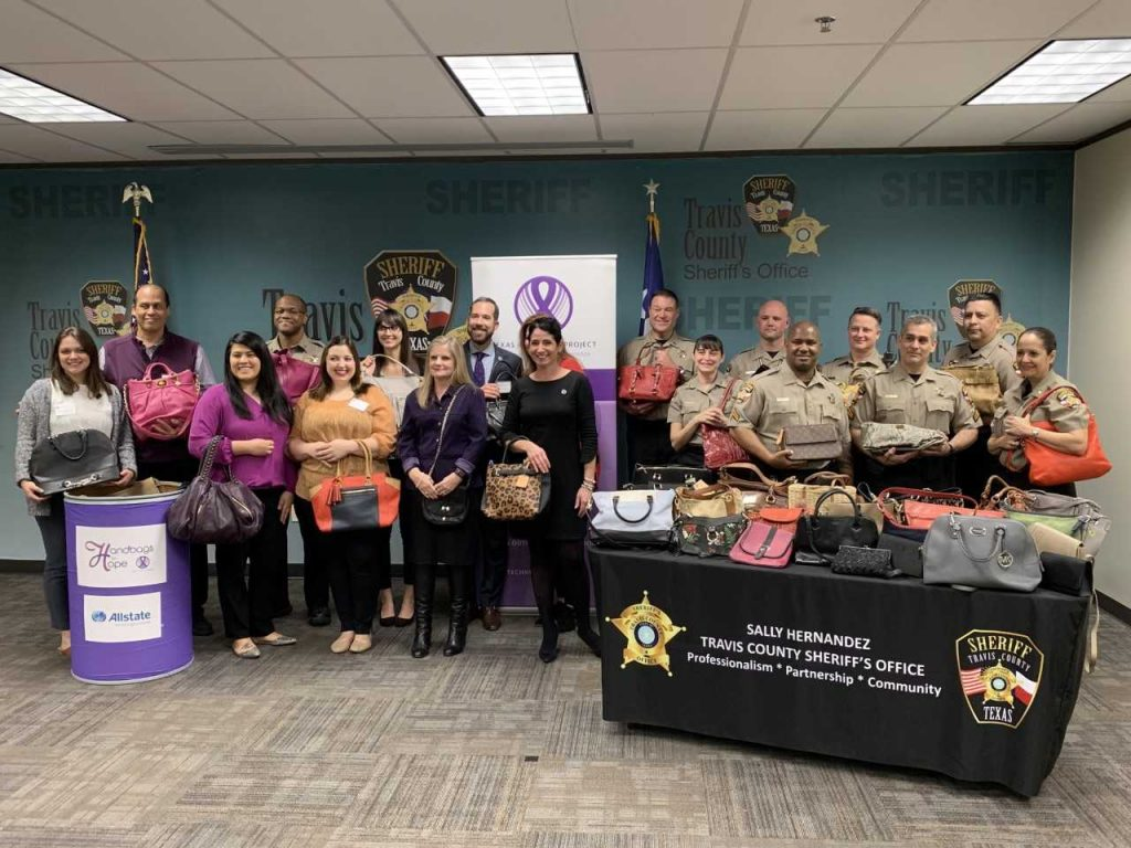 Texas Advocacy Project and Travis County Sheriff's office Handbags for Hope