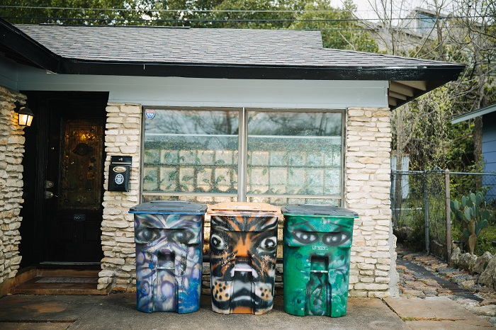 Painted garbage and recycling bins in Austin