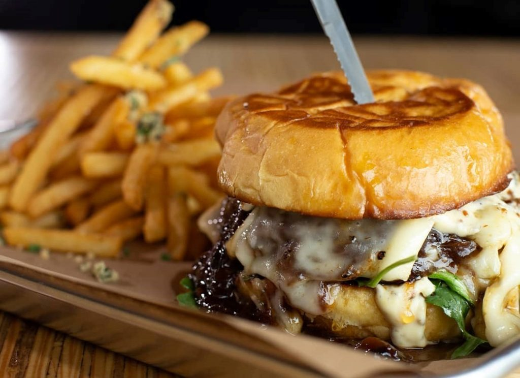 Buy one, get one burger half off at Revelry on the Boulevard Austin