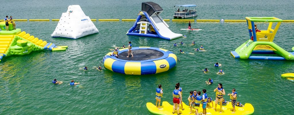 Waterloo Adventures Aqua Park With giant floating trampoline and water slide on lake
