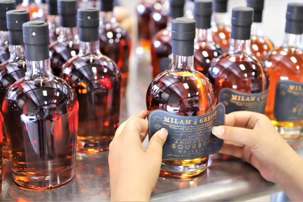 Labels on Milam & Greene Whiskey Bottles